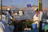 Djemaa El Fna. Market stall with two men cooking food