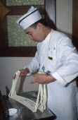 Lanzhou. A cook demonstrating how to make noodles by hand.