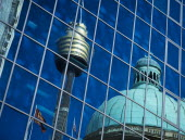 Reflection of the dome of the Queen Victoria building and the AMP / Sydney Tower seen in glass building