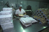 Female worker packing goats cheese at Fairview goats cheese and wine estate