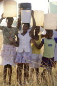 Hopewell  young girls carrying water on their heads from the Umgeni Water community water tap.