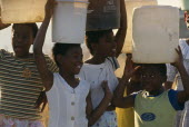 Young girls carrying water on their heads drawn from the Umgeni Water community water tap  Hopewell.