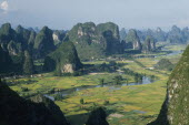 View from Moonhill with Karst limestone formations around the river valley with rice paddies