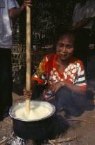 Karen refugee woman in Mae Lui village preparing Soya in a pot