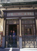 Macarena District El Rinconcillo where Tapas originated with two men standing at a window