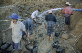Gold workers at the source of the Ayeyarawady River at the confluence of the Mali Kha and the Ma Kha rivers in upper Myanmar.Burma