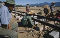 Making repairs to the single railway track on the Mandalay to Myitkyina line. Burma