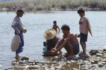 Kachin people panning for Gold in the upper Ayeyarwady RiverBurma Myanmar