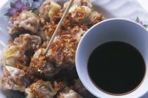 Thai style steamed pork filled dumplings with a bowl of Chinese sweet vinegar called Khanom jiip