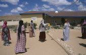 Girls playing volleyball at Fatima Bihi school wearing long skirts and head coverings.