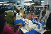 Female employees working in garment factory.
