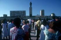 Memorial Day crowds below a towering statue of Che Guevara at the battle site memorial