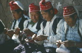 Taquile Island.  Line of men knitting.