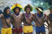 Xikrin Indian men wearing feathered head dresses dancing.Brasil Kayapo Brazil Kaiapo Mebengorke