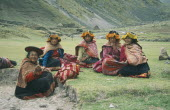 Local Quechuan women sat on grass  wearing traditional dress. Cuzco  Sacred Valley  Andes Cuzco  Sacred Valley  Andes