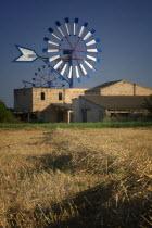 Farm with windmills near Palma de Mallorca.MajorcaMediterraneanTravelTourismHolidaysHarvestMolins de CamposAgricultureFarmingWindmill. Wind Power