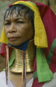 Woman from Karen tribe wearing traditional neck rings.  Refugee from Myanmar living in guarded village. Burma