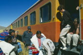 Train stopped at the altiplano on the highest pass on the line between Puno to Cusco  passengers disembarking.