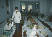 Cataract camp with man wearing surgical mask