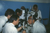 Man leaning his head on a rest having an Orbis Eye Examination