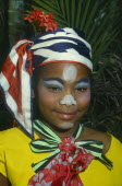 Head and shoulders portrait of girl in costume and face paint.