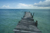 Derelict wooden jetty leading out to sea