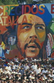 Crowd in front of  giant Che Guevara painting at 35th Anniversary of The Revolution