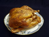 Roast Turkey and mixed herbs on a plate.
