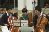 Three teenage male Cello players in the United Freedom Orchestra joke about music during a rehearsal break.left is Kazuto Sawawatari  17 years old  MR 4  center is Shyota Sawawatari  17 years old  M...