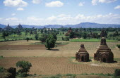 Two Temples in a field with others seen in the distance