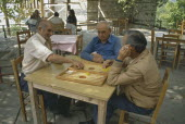 Men Playing Backgammon outydoors