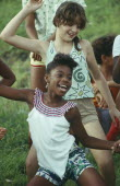 Young black and white girls dancing
