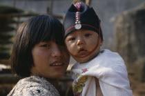 Portrait of two Akha tribe children near Chiang Rai.