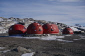Red capsule fibreglass accommodation for remote field camps which can be transported by helicopter