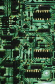 Green circuit board with resistors chips switches etc