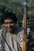 Man clutching hardwood bow and quiver of steel-headed arrows for mammals and birds  clay pipe for tobacco  wearing woven cotton  manta   / cloak.Indigenous Tribes American Colombian South America Col...