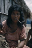 Mother smoking tobacco in a clay pipeIndigenous Tribes American Colombian Mum South America Columbia Hispanic Indegent Latin America Latino