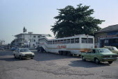 Street scene with bus and other traffic. Zaire