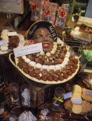 A shop display of an assortment of hand made chocolates