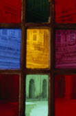 Jodhpur fort seen through coloured rectangles of stained glass door. Colored