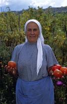 Farmer holding tomatoes in field.TravelTourismHolidayVacationExploreRecreationLeisureSightseeingTouristAttractionTourDobarskoBanskoBulgariaBulgarianTranquilTranquilityEastEasternEu...