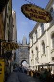 Karlova Street lined with food stalls leading to the Old Town Bridge Tower on the Charles Bridge. An overhead sign advertises traditional Black Light TheatrePraha Ceska Eastern Europe European Theate...