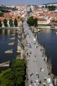 People walking on The Charles Bridge across the Vltava River leading to the Little QuarterPraha Ceska Eastern Europe European