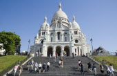 Montmartre Steps filled with tourists leading up to the front of the church of Sacre CouerEuropean French Religion Western Europe