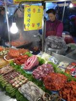 Namdaemun - Namdaemun Market  December evening  food stall with chicken  meat  and fish waiting to be cookedAsia Asian Japanese Nihon Nippon Classic Classical Daehanminguk Hanguk Historical Korean Ol...