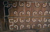 Detail of Barasana painted design including spirit guard figure  on front of maloca/communal home.Tukano sedentary tribe Indian North Western Amazonia maloca American Colombian Columbia Hispanic Inde...