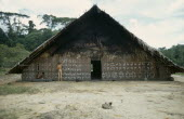 Barasana man painting design on front of maloca or communal home helped by anthropologist Stephen Hugh-Jones.  Tukano sedentary tribe Indian North Western Amazonia maloca American Colombian Columbia...