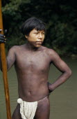Rio Verde  a young Embera  with lower face and body painted with black dye extracted from the inedible Jagua fruit holding a palanca/pole - used for guiding canoe through rapids on rio Condoto.Pacifi...