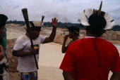 Garimpo  goldmine on former Panara territory.  Headman Aka declaims against actions of garimpeiros resulting in the environmental                     ruin of Panara homelands.Garimpeiro small scale p...