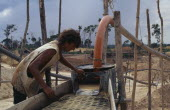 Garimpeiro washing mine tailings for gold on former Panara territory.Small scale garimpeiro prospectors mners in informal sector have                      displaced Panara Indians formerly known as K...